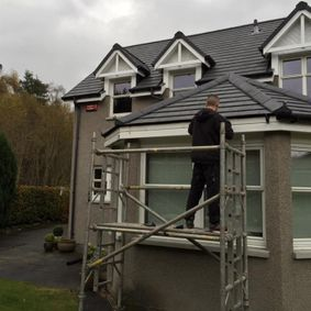 one of our team fixing a customers roof