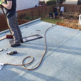 flat roof with sweeping brush
